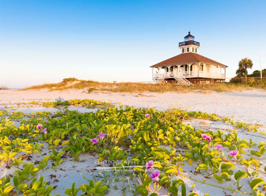 Port Boca Grande Lighthouse at sunrise with blue sky