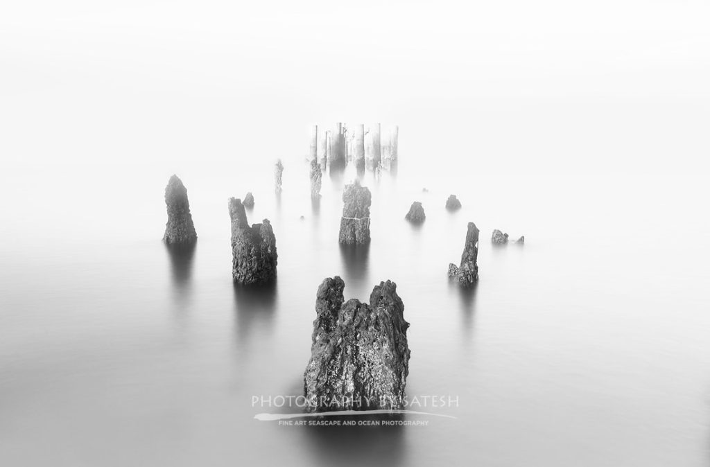 Florida black and white photo of the Old Naples Pier covered in fog